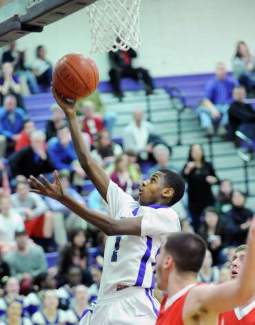Jeremiah Livingston # 1 of Westhill blows by two Greenwich defenders to score on a layup during the boys high school basketball game between Westhill High School and Greenwich High School at Westhill in Stamford, Friday night, Feb. 1, 2013. Photo: Bob Luckey / Greenwich Time