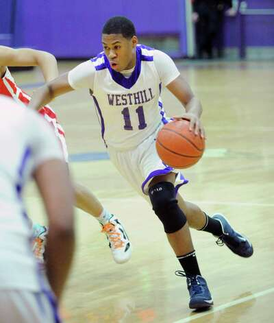 Guyveson Cassamajor # 11 of Westhill drives to the basket during the boys high school basketball game between Westhill High School and Greenwich High School at Westhill in Stamford, Friday night, Feb. 1, 2013. Photo: Bob Luckey / Greenwich Time