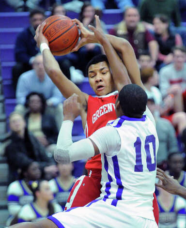At left, CJ Byrd of Greenwich grabs a rebound over Yveson Cassamajor #10 of Westhill during the boys high school basketball game between Westhill High School and Greenwich High School at Westhill in Stamford, Friday night, Feb. 1, 2013. Photo: Bob Luckey / Greenwich Time
