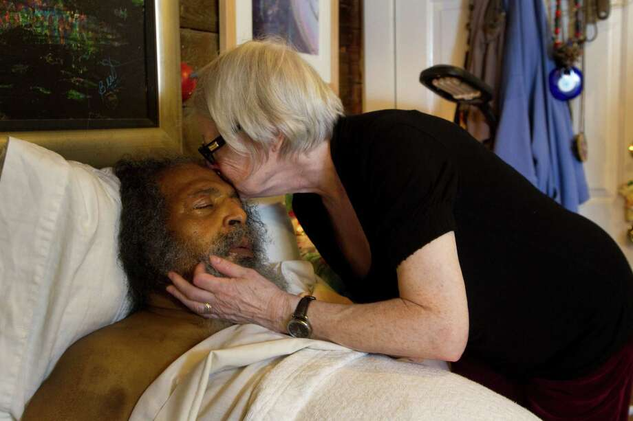 Joan Batson kisses her husband Bert Long on the forehead Monday, Jan. 28, 2013, in Houston. Long, 72, an influential Houston artist, who has picked cotton, waited tables, worked as a French chef and since he was 39 sculpted ice, now has stage 4 pancreatic cancer and now unable to create. Photo: Brett Coomer, Houston Chronicle / © 2013 Houston Chronicle