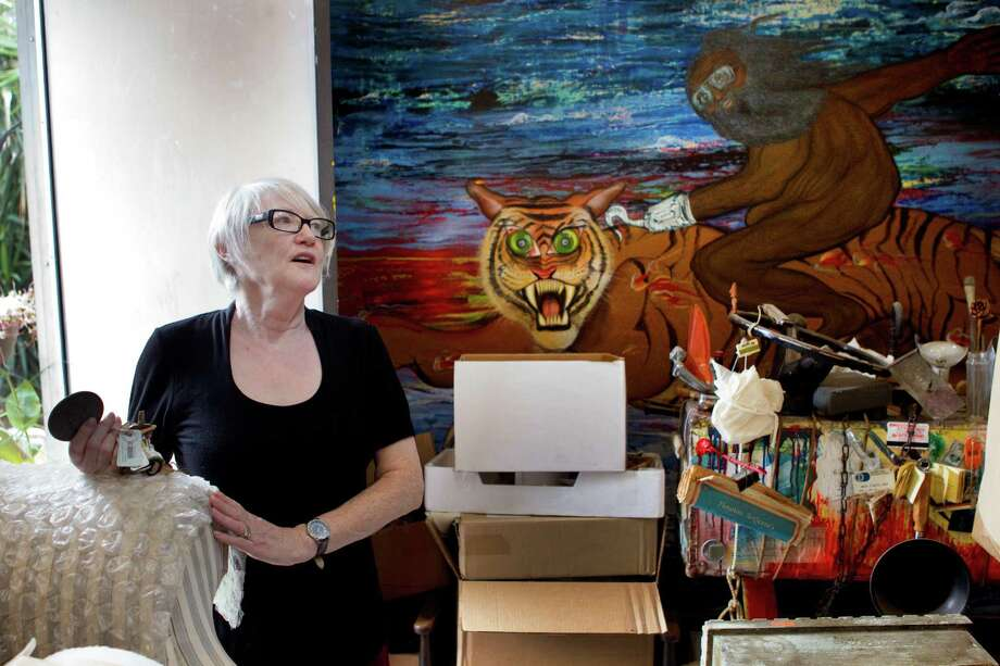 Joan Batson, wife of artist Bert Long, stands in Long's studio near one of his well-known paintings Monday, Jan. 28, 2013, in Houston. Photo: Brett Coomer, Houston Chronicle / © 2013 Houston Chronicle
