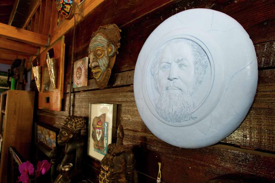 Various sculptures and works of art adorn the walls of Bert Long's home Monday, Jan. 28, 2013, in Houston. Photo: Brett Coomer, Houston Chronicle / © 2013 Houston Chronicle