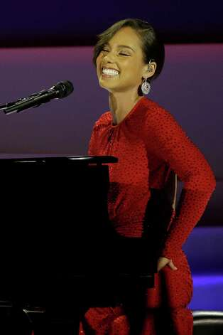 Alica Keys performs during Inaugural Ball in the Washington Convention Center at the 57th Presidential Inauguration in Washington, Monday, Jan. 21, 2013. (AP Photo/Paul Sancya) Photo: Paul Sancya, Associated Press / AP