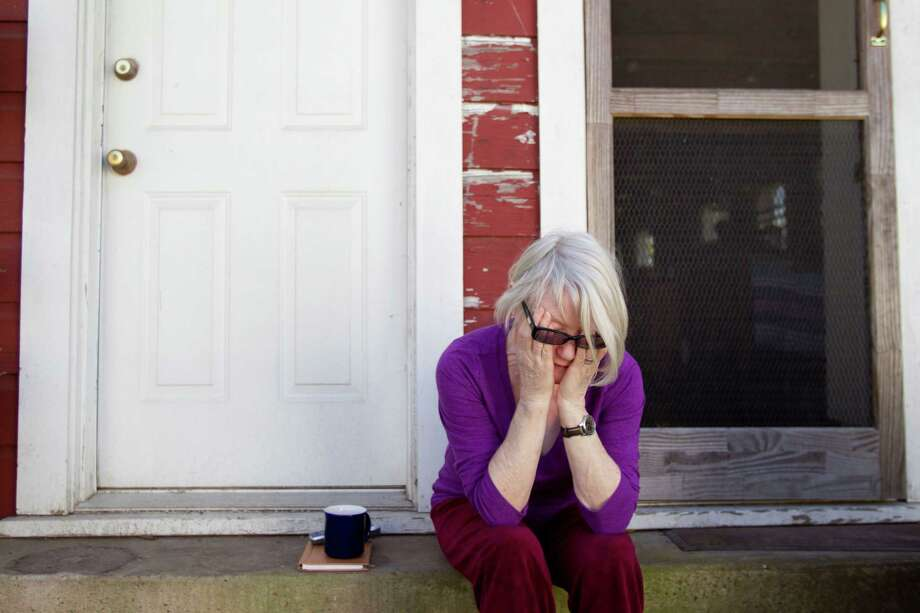 Joan Batson, wife of artist Bert Long, wipes her eyes as she sits alone on her back porch following the death of her husband Friday, Feb. 1, 2013, in Houston. Photo: Brett Coomer, Houston Chronicle / © 2013 Houston Chronicle