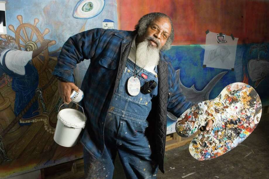 Artist Bert Long, 67, works on a mural in his studio Tuesday, Nov. 27, 2007, in Houston. The mural his is calling Art/Life is slated to be installed at the Looscan Public Library when it is finished. Photo: Brett Coomer, Chronicle / Houston Chronicle