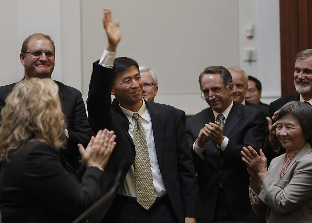 University of California, Berkeley law professor Goodwin Liu waves after he was confirmed by a three member appointment board of the Commission on Judicial Appointments in San Francisco, Wednesday, Aug. 31, 2011. Lower right is his mother, Yang Ching Liu.