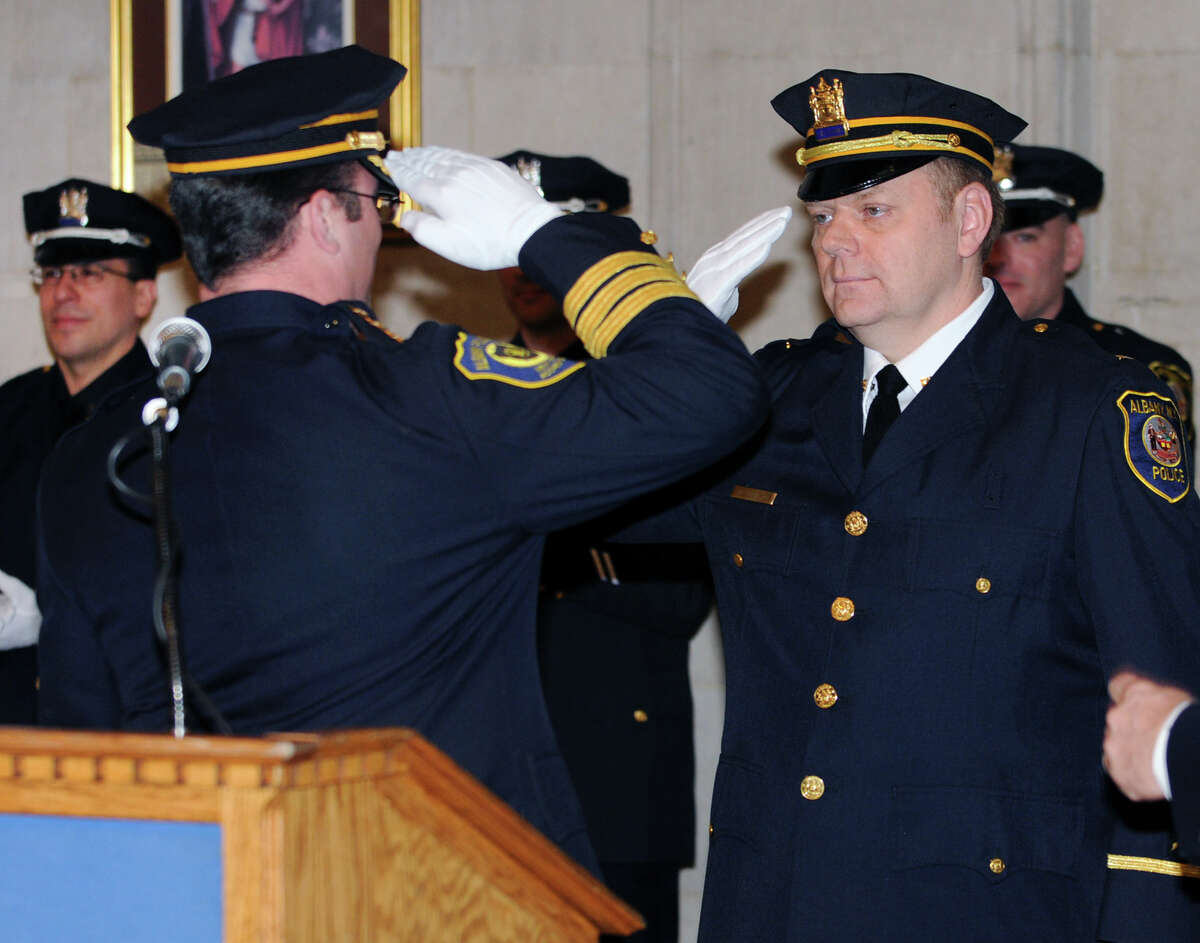 Chief Steven Krokoff salutes Lt. Michael Basile for his promotion during a swearing in ceremony of nine newly promoted members of the Albany Police Department at City Hall Friday Feb. 1, 2013 in Albany, N.Y. (Lori Van Buren / Times Union)