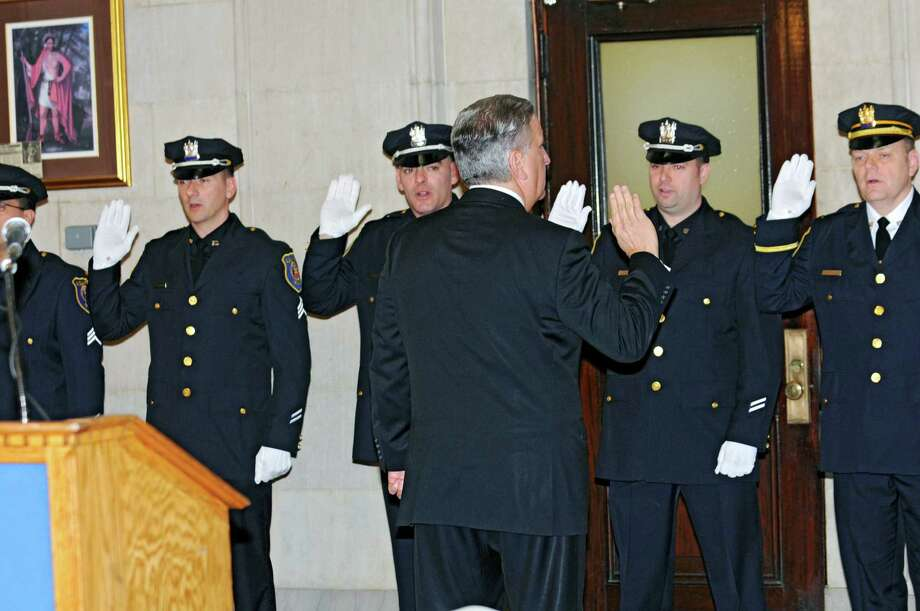 Mayor Jerry Jennings swears in nine newly promoted members of the Albany Police Department at City Hall Friday Feb. 1, 2013 in Albany, N.Y.  (Lori Van Buren / Times Union) Photo: Lori Van Buren