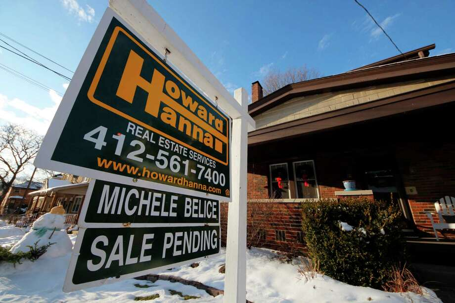 In this  Jan. 5, 2013, photo, a home is shown with a sale pending sign in Mount Lebanon, Pa. Photo: Gene J. Puskar, Associated Press / Associated Press
