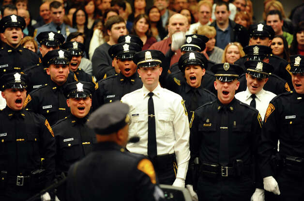 Twenty-eight new police officers from the Bridgeport Police Academy let out a cheer after completing the graduation ceremony at Bridgeport City Hall's Council Chambers in Bridgeport, Conn. on Friday February 1, 2013. Photo: Christian Abraham / Connecticut Post