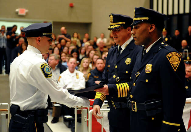 Twenty-eight new police officers from the Bridgeport Police Academy take part in a graduation and swearing-in ceremony at Bridgeport City Hall's Council Chambers in Bridgeport, Conn. on Friday February 1, 2013. Photo: Christian Abraham / Connecticut Post