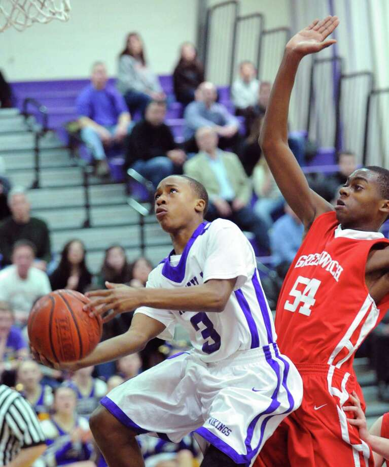 At left, C.J. Donaldson # 3 of Westhill gets past Leonel Hyatt # 54 of Greenwich to score on a layup durng the boys high school basketball game between Westhill High School and Greenwich High School at Westhill in Stamford, Friday night, Feb. 1, 2013. Photo: Bob Luckey / Greenwich Time