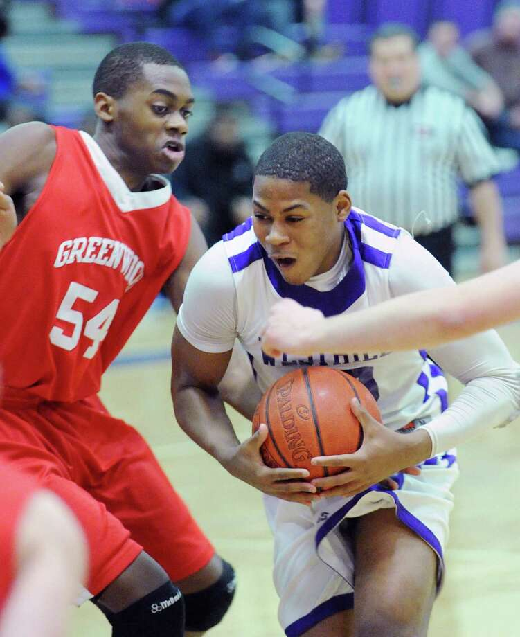 At left, Leonel Hyatt # 54 of Greenwich covers Westhill's Yveson Cassamajor # 10, during the boys high school basketball game between Westhill High School and Greenwich High School at Westhill in Stamford, Friday night, Feb. 1, 2013. Photo: Bob Luckey / Greenwich Time