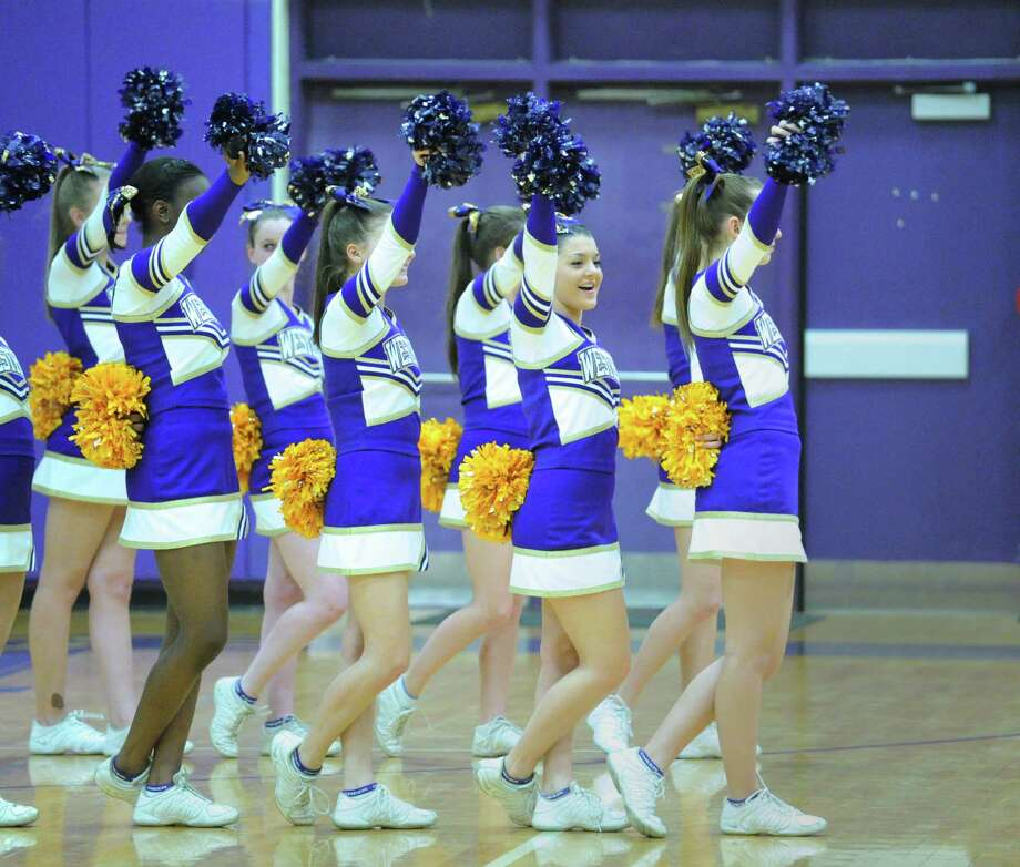 The Westhill cheerleaders in action during the boys high school basketball game between Westhill High School and Greenwich High School at Westhill in Stamford, Friday night, Feb. 1, 2013. Photo: Bob Luckey / Greenwich Time