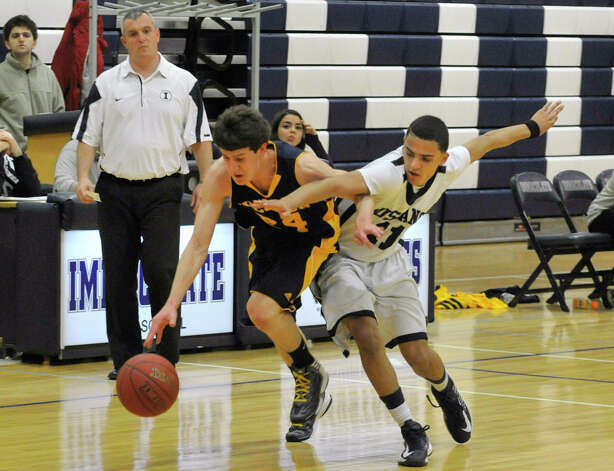 Weston's Charlie DiPasquale fends off Immaculate's Darel Bowman during their game at Immaculate High School in Danbury on Friday, Feb. 1, 2013. Immaculate won, 63-54. Photo: Jason Rearick / The News-Times
