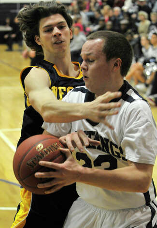 Weston's Troy Flynn pressures Immaculate's Mike Scharfenberg during their game at Immaculate High School in Danbury on Friday, Feb. 1, 2013. Immaculate won, 63-54. Photo: Jason Rearick / The News-Times