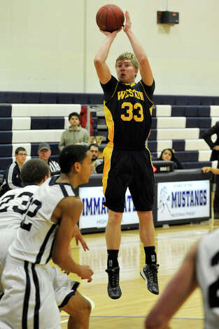 Weston's Erik Dammen-Brower shoots the ball uncontested during their game against Immaculate at Immaculate High School in Danbury on Friday, Feb. 1, 2013. Immaculate won, 63-54. Photo: Jason Rearick / The News-Times
