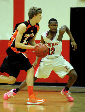 Ridgefield's #34 Kurt Steidl drives the ball as Central's #12 Rickardo Grant defends, during boys basketball action in Bridgeport, Conn. on Friday February 1, 2013. Photo: Christian Abraham / Connecticut Post