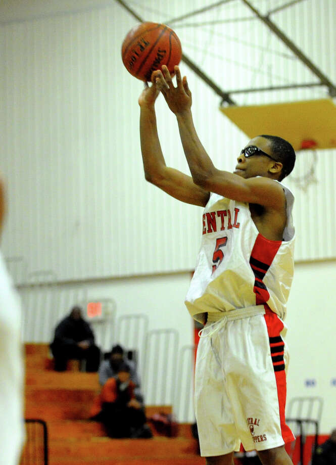 Central's #5 Dondre Daniels attempts a shot, during boys basketball action against Ridgefield in Bridgeport, Conn. on Friday February 1, 2013. Photo: Christian Abraham / Connecticut Post