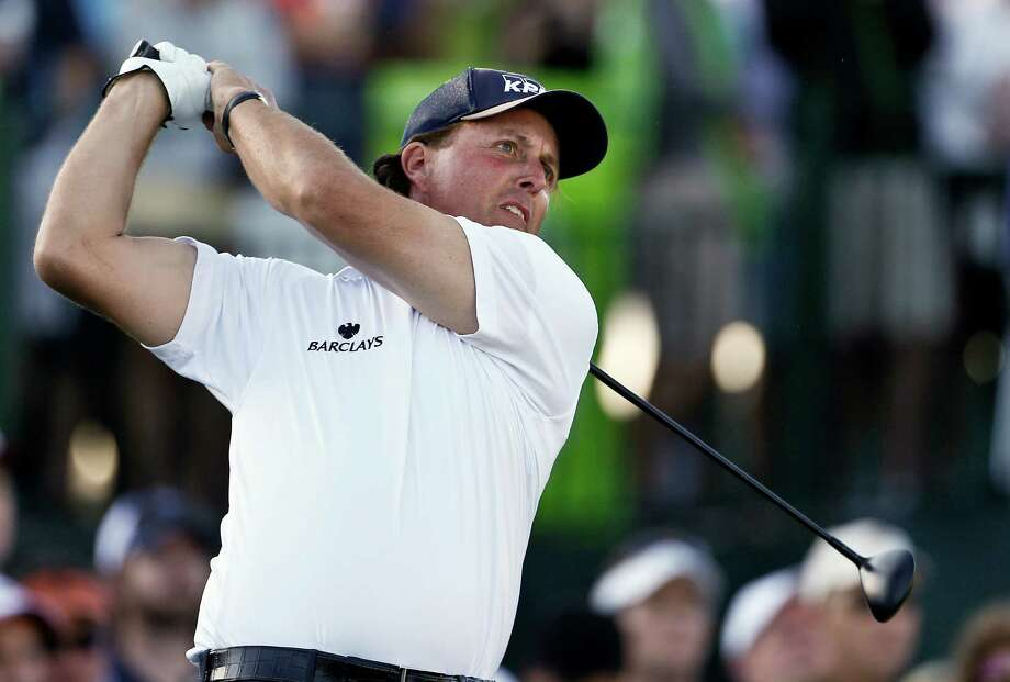 If not for a wayward drive on No. 18, Phil Mickelson had a good chance of setting 36-hole scoring records not only at the Phoenix Open but also for the PGA Tour. Photo: Ross D. Franklin, STF / AP
