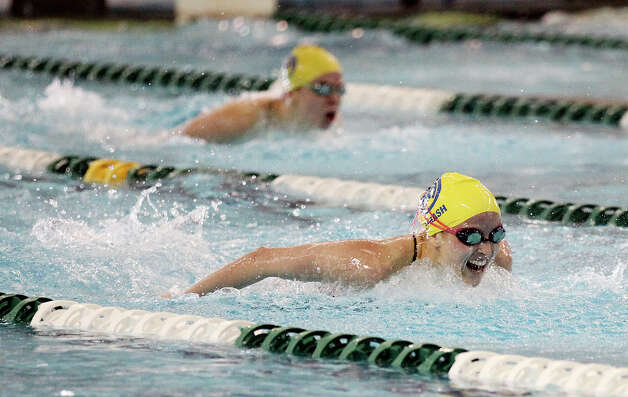 Alamo Heights' Hennelore Strash swims the 100-yard butterfly at the District 29-4A swim meet at Palo Alto College on Friday, Feb. 1, 2013. Strash took first with a time of 57.43. Photo: Kin Man Hui, Express-News / © 2012 San Antonio Express-News