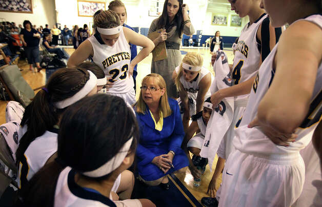 Poth High School girls basketball coach Peggy Hosek (center) coaches her last regular season home game after 32 years as head coach in Poth, Texas on Friday, Feb. 1, 2013. Hosek has more than 800 wins, two Class 2A state titles and 12 trips to the state tournament as part of her coaching legacy. Photo: Kin Man Hui, Express-News / © 2012 San Antonio Express-News