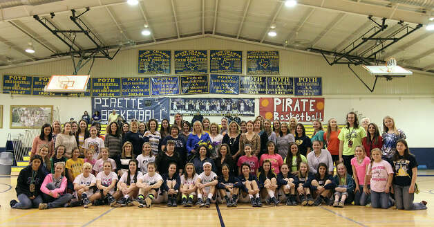 Poth High School girls basketball coach Peggy Hosek (center) is retiring after 32 years as head coach. Hosek joined former and current players she has coached for a group photo before her last home game in Poth, Texas on Friday, Feb. 1, 2013. Hosek has more than 800 wins, two Class 2A state titles and 12 trips to the state tournament as part of her coaching legacy. Photo: Kin Man Hui, Express-News / © 2012 San Antonio Express-News