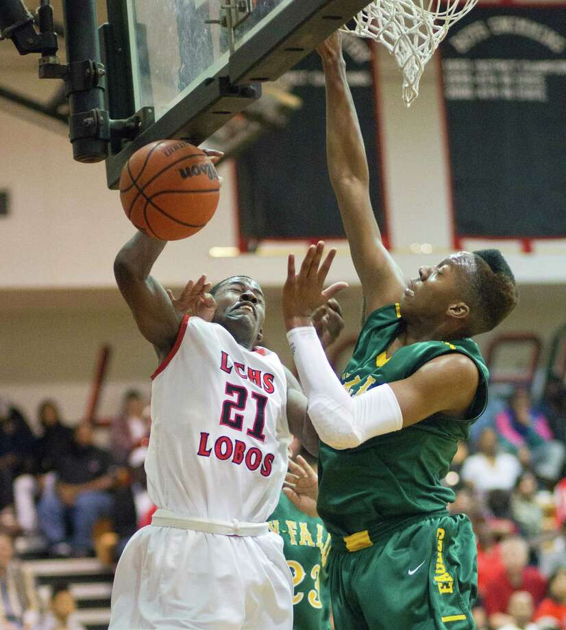 Langham Creek's Eric Thomas (21) looses the ball as he drives against Cy-Falls' Antonio Pirtle (30) during a District 17-5A basketball game between Cy-Falls and Langham Creek, Friday, February 1, 2013. Cy-Falls wins in overtime. (Bob Levey/For The Chronicle) Photo: Bob Levey, Houston Chronicle / ©2013 Bob Levey