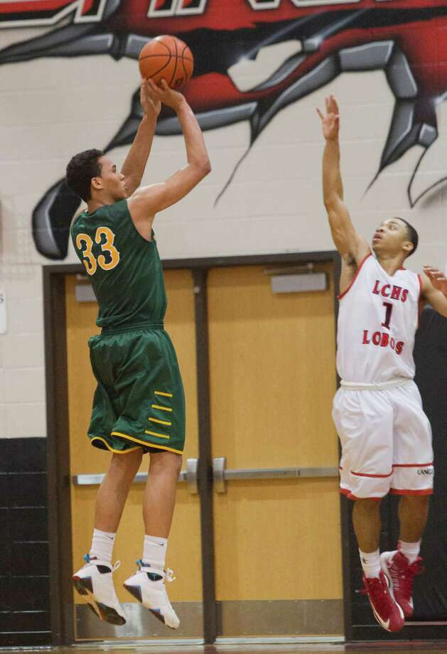 Cy-Falls' Kavin Tilbury (33) ties the game with a shot over Langham Creek's Jerome Segura (1) during a District 17-5A basketball game between Cy-Falls and Langham Creek, Friday, February 1, 2013. Cy-Falls wins in overtime. (Bob Levey/For The Chronicle) Photo: Bob Levey, Houston Chronicle / ©2013 Bob Levey