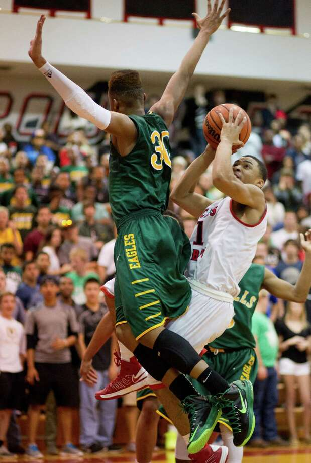 Langham Creek's Jason Segura (1) is net by Cy-Falls' Antonio Pirtle (30) as he makes a move to the basket during a District 17-5A basketball game between Cy-Falls and Langham Creek, Friday, February 1, 2013. Cy-Falls wins in overtime. (Bob Levey/For The Chronicle) Photo: Bob Levey, Houston Chronicle / ©2013 Bob Levey