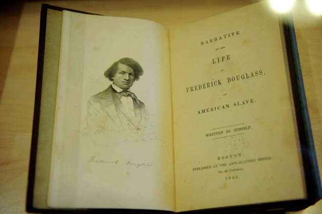 A rarely-displayed first-edition Frederick Douglas autobiography from the New York State Archives is part of the Black History Month exhibit on Friday, Feb. 1, 2013, at the Capitol in Albany, N.Y. The exhibit, on display through the month of February, is located on the second floor in the East Gallery. (Cindy Schultz / Times Union) Photo: Cindy Schultz / 10021011A