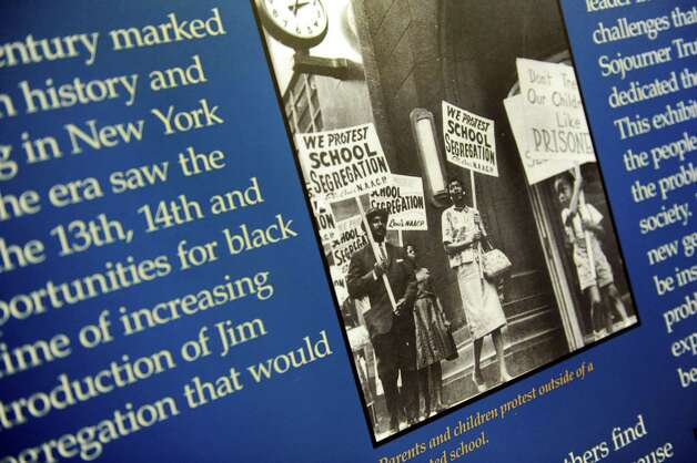 A poster featuring the Civil Rights Movement is part of the Black History Month exhibit on Friday, Feb. 1, 2013, at the Capitol in Albany, N.Y. The exhibit, on display through the month of February, is located on the second floor in the East Gallery. (Cindy Schultz / Times Union) Photo: Cindy Schultz / 10021011A