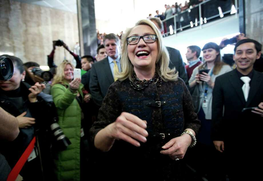 Secretary of State Hillary Rodham Clinton, center, smiles as she bids farewell to State Department employees at the State Department lobby in Washington, Friday, Feb. 1, 2013, before departing the State Department for the final time as secretary of state.   (AP Photo/Manuel Balce Ceneta) Photo: Manuel Balce Ceneta