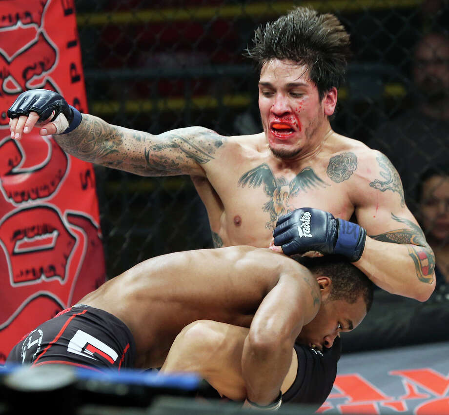 Jamall Emmers takes down Ernest De La Cruz during the Mixed Martial Arts card at Cowboys Dancehall on Friday.  Emmers would go on to win the match. Photo: Tom Reel, San Antonio Express-News / ©2012 San Antono Express-News