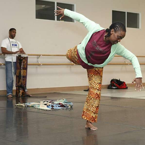 Latanya d. Tigner and Kiazi Malonga rehearse a collaborative music and dance piece for the Black Cho