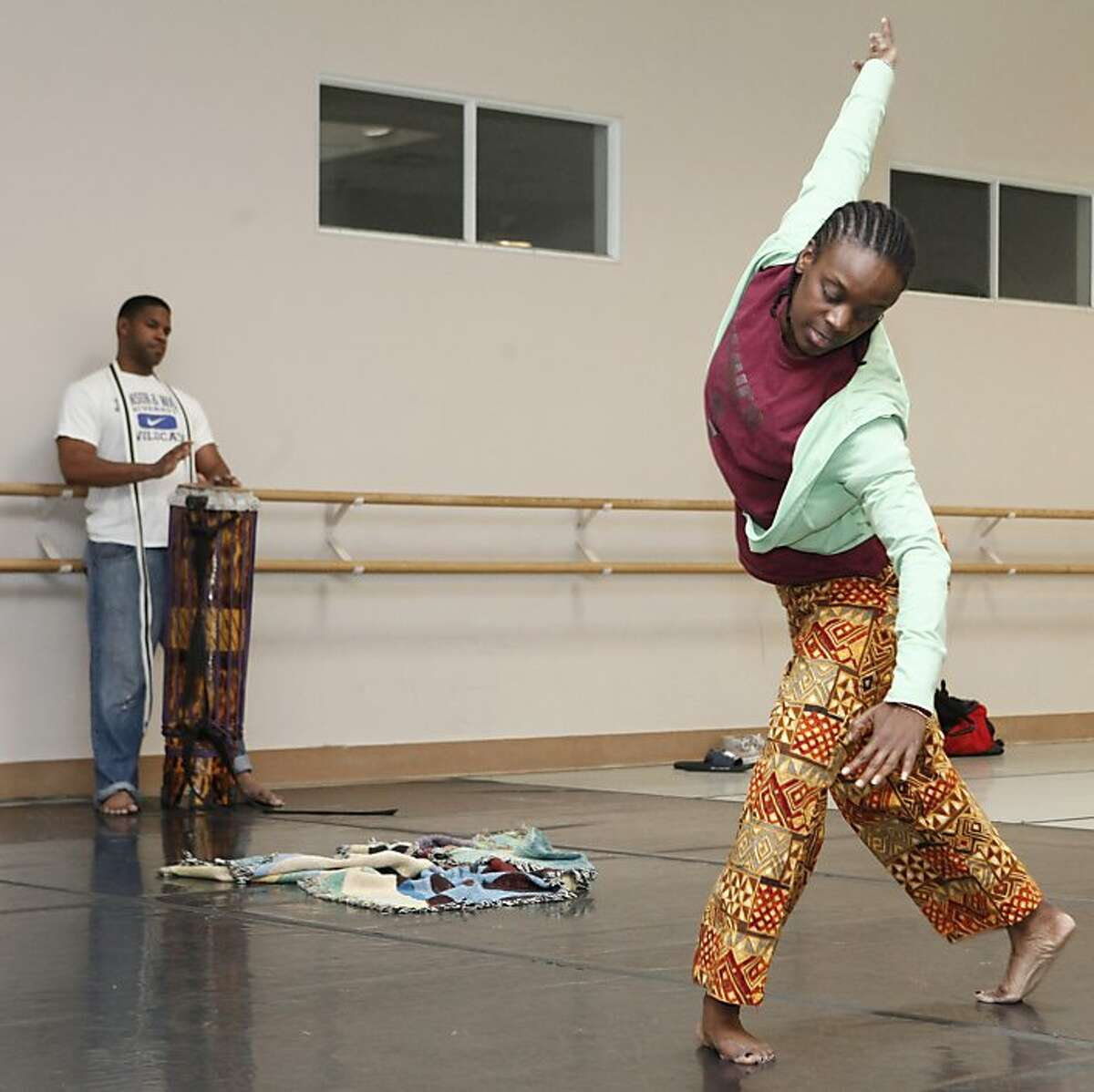 Latanya d. Tigner and Kiazi Malonga rehearse a collaborative music and dance piece for the Black Choreographers Festival at the Malonga Casquelourd Center for the Arts in Oakland Calif. on Saturday, Jan. 26, 2013. The dance Tigner performs is partially contemporary and partially based in Congolese dance traditions. Tigner and Malonga have been collaborating for about two years on this piece which origionally debuted in 2012.