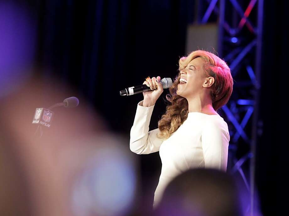 Beyonce began her Super Bowl news conference by belting out the National Anthem, which she mouthed in Washington. Photo: Brant Ward, The Chronicle