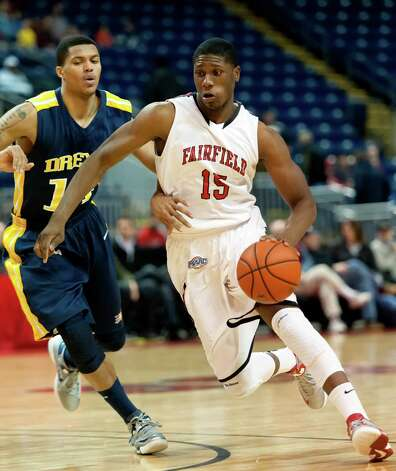 Fairfield University's Maurice Barrow drives past Drexel University's Damion Lee in a men's basketball game played at the Webster Bank Arena, Bridgeport, CT on Sunday December 16th, 2012. Photo: Mark Conrad / Connecticut Post Freelance