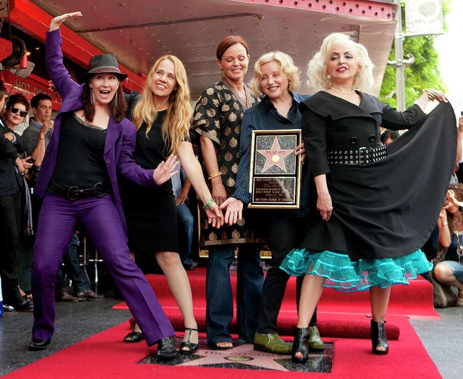 From left, Kathy Valentine, Charlotte Caffey, Belinda Carlisle, Gina Schock and Jane Wiedlin receive a star on the Hollywood Walk of Fame in 2011, in Los Angeles. The Go-Go's still tour. Photo: Damian Dovarganes, ASSOCIATED PRESS / AP2011