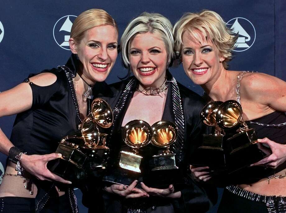 The Dixie Chicks — Emily Robison, Natalie Maines and Martie Maguire — won over a dozen Grammys and sold more than 30 million records. But some still know them best for when Maines said before the U.S. invasion of Iraq in 2003, 'We're ashamed that the President of the United States is from Texas.' Here they are at the Grammys in 1999. Photo: REED SAXON, ASSOCIATED PRESS / AP1999
