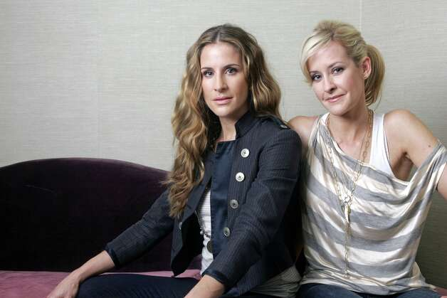 Dixie Chicks sisters  Emily Robison, left, and Martie Maguire also recorded under the name Courtyard Hounds.  Here they are in 2010. Photo: BruceGilbert, ASSOCIATED PRESS / AP2010