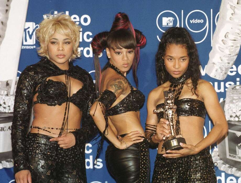 TLC — Tionne 'T-Boz' Watkins, Lisa 'Left Eye' Lopes and  Rozonda 'Chilli' Thomas — seen here at the  1999 MTV Video Music Award taking home an award for 'No Scrubs.' They were one of the most successful acts of the '90s. Photo: HENNY RAY ABRAMS, AFP/Getty Images / AFP