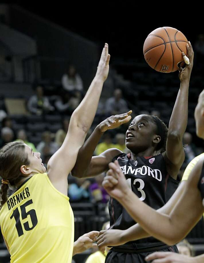 Stanford forward Chiney Ogwumike shoots over Oregon forward Liz Brenner during the first half. Photo: Don Ryan, Associated Press