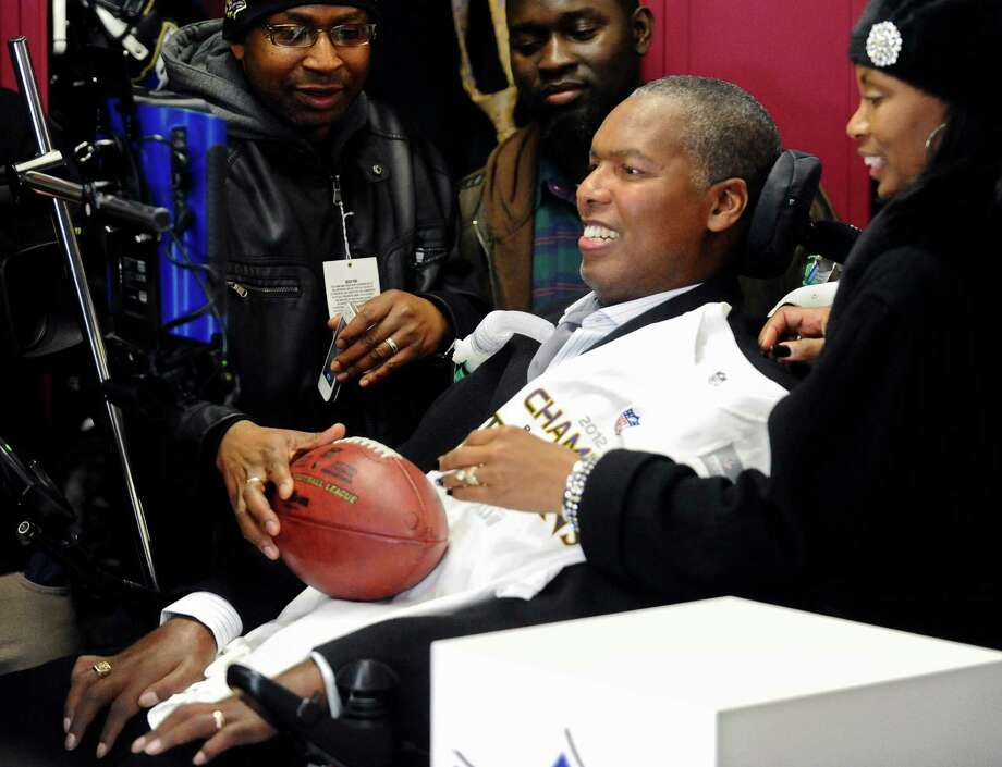 O.J. Brigance's ever-smiling presence in the face of ALS earned him the game ball after the Ravens beat New England in the AFC Championship Game. Photo: Kenneth K. Lam, MBR / Baltimore Sun