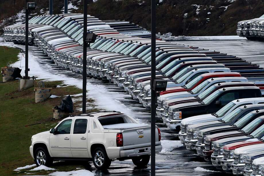 Chevy trucks line the lot of a dealer in Murrysville, Pa. GM and most other automakers reported gains for January as last year's momentum continued into 2013. Photo: Gene J. Puskar, STF / AP