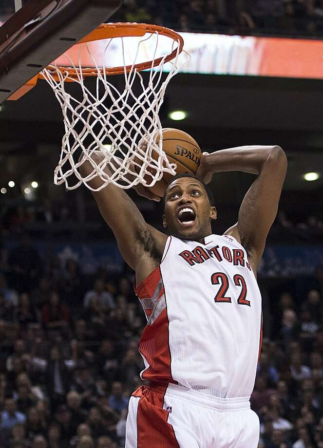 New Raptor Rudy Gay rises up for a dunk and two of his game-high 20 points. Photo: Nathan Denette, Associated Press