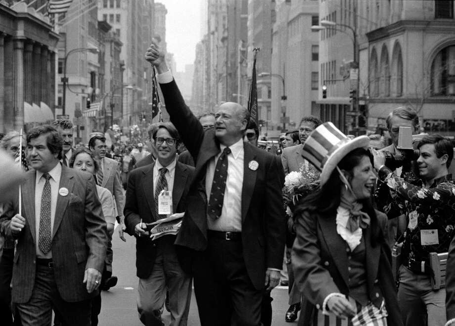 In this Sept. 7, 1981 file photo, New York City Mayor Ed Koch, center,  gestures as he marches in a Labor Day parade down New York's Fifth Avenue. Koch died Friday, Feb. 1, 2013 from congestive heart failure, spokesman George Arzt said. He was 88. (AP Photo/Perez, file) Photo: Perez