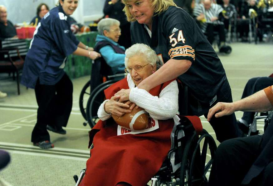 Old Timers running back Mabel Carcia, 87-years-old, is pushed by Pat Schultz during Wheelchair Bowl