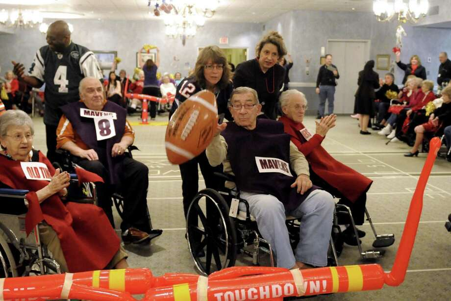 Mavens John Rothlauf, age 90, puts the extra point through the uprights during Wheelchair Bowl X at Teresian House on Friday afternoon, Feb. 1, 2013, in Albany, N.Y. The Old Timers beat the Mavens 21-19. (Michael P. Farrell/Times Union) Photo: Michael P. Farrell