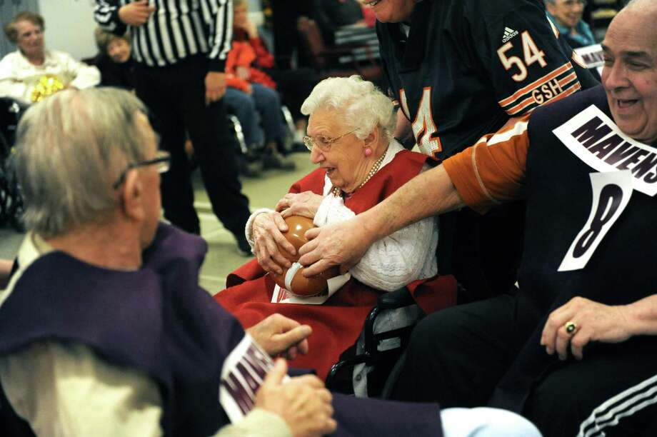 Old Timers running back Mabel Carcia, age 87, breaks through a hole in the Mavens defense during Wheelchair Bowl X at Teresian House on Friday afternoon, Feb. 1, 2013, in Albany, N.Y. The Old Timers beat the Mavens 21-19. (Michael P. Farrell/Times Union) Photo: Michael P. Farrell